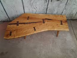 cherry live edge crotch slab coffee table with walnut bowties