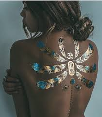 picture of scarab and feather gold and black henna tattoo on the back