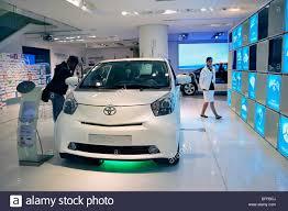 toyota car showroom paris france man shopping in new car showroom toyota car iq