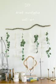 diy dried eucalyptus decor eucalyptus wall art diy dried eucalyptus and white flower decor idea for your home only scissors and twine