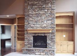 stone fireplace built in bookshelves massive stone fireplace