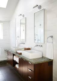 a home that redefines the meaning of green serpentinite countertops and dark wood cabinetry sidestep the all white bathroom trend in