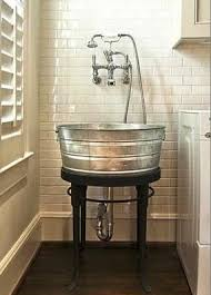 galvanized tub kitchen sink wash basin out of a galvanized bucket great for laundry room if