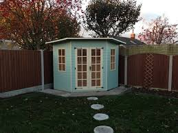 The Summer And Winter Garden - light blue green pent roof corner summerhouse perfect for
