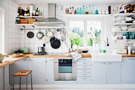 white kitchen design ideas with pendant lamp and white open