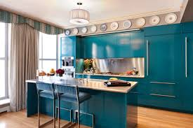 stylish kitchen build with blue cabinet colors with plates as
