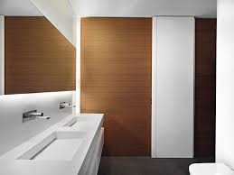 excellent master bedroom decor with brown varnished wood paneling