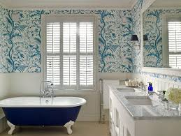 blue willow wallpaper laundry room transitional with white door