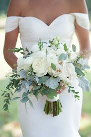 white wedding bouquets white ranunculus and eucalyptus bouquet dragonfly events