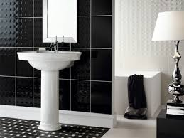 modern bathroom using black and white mosaic tiles as flooring and