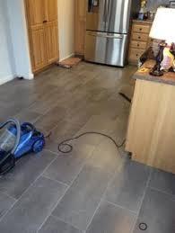 Laminate Tile Flooring Kitchen by 1 08 Sq Ft Trafficmaster Ceramica 12 In X 24 In Coastal Grey