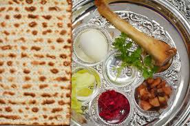seder meal plate matzo bread next to passover seder plate with the seventh symbolic