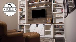 Floating Shelves Entertainment Center by How To Make A Sliding Barn Door Entertainment Center Faux Barn