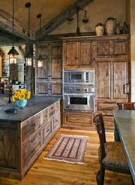 farmhouse kitchen with oak cabinets rustic farmhouse engrained cabinetry countertops
