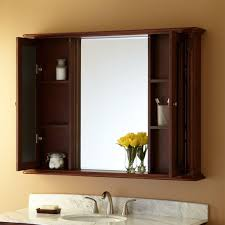 bathroom large brown wood medicine cabinet with mirrored doors