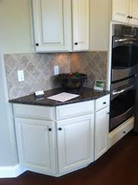 Baltic Brown Granite Countertops With Light Tan Backsplash by Baltic Brown Granite Antique White Cabinets For The Home