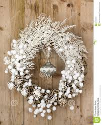 white christmas wreath on brown wooden vintage background stock