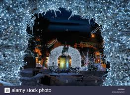 bright christmas lights on elk antler arches in jackson wyoming