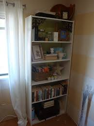 cheap white walmart bookshelves with three drawers and cozy berber