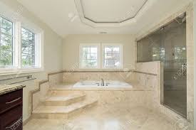 Marble Master Bathroom by Master Bath In New Construction Home With Marble Tub Stock Photo
