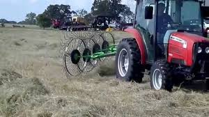 raking hay with a sfi 4 wheel hay rake youtube