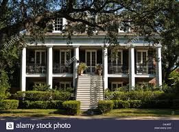 house in new orleans with spiders set up for halloween stock photo