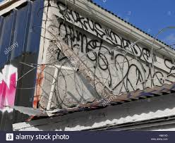 Roof Razor by Low Angle View Of Razor Wire Fence On Roof Stock Photo Royalty