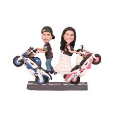 motorcycle wedding cake toppers and groom stand on the motorcycle wedding cake toppers