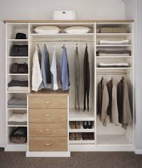 signature deluxe bedroom closet in an antique white finish