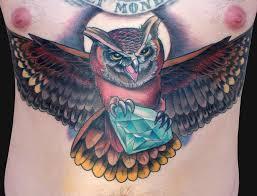 owl holding by katelyn crane tattoos