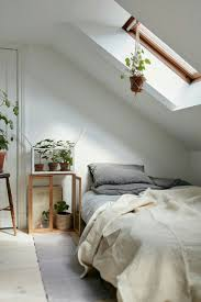 best 25 sloped ceiling bedroom ideas only on pinterest rooms guest room attic bedroom in a charming plant filled attic apartment in sweden gravity home