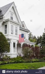 american flag on a vintage colonial house new jersey usa stock