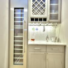classy blue color built in wine fridge with blue color kitchen