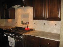 tumbled stone backsplash traditional kitchen design with brown