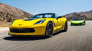 corvette stingray gold corvette z06 cabrio vs lambo aventador roadster