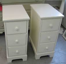 white stained bed side table with three drawer and rounded sweet white wooden polished pair of three drawers bedside table with