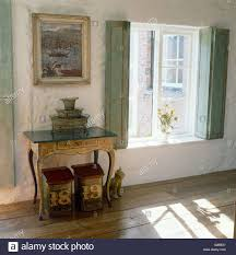 bedroom with french style interior windows with shutters stock