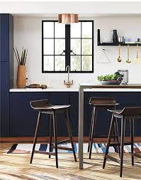 kitchen island and stools 11 bar stools that ll help create a cohesive design in an open