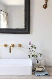 Bathroom Sink Wall Faucets by Minimalist Bathroom With Aged Brass Wall Mount Faucet Modern