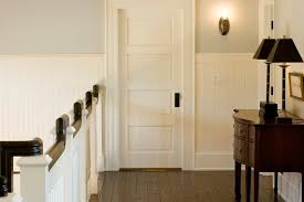 Wainscot Kit Cottage Hallway With Wall Sconce By Mitch Wise Design Inc