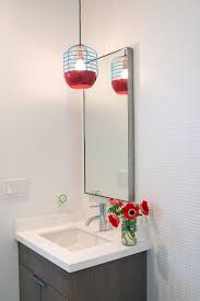 cherry red accents found in the pendant light and floral