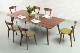 solid american walnut dining table with green walnut chairs