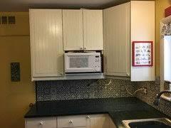 ikea kitchen cabinet doors peeling ikea akurum kitchen cabinet doors and draws in need of repair