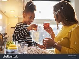 mom child kitchen drinking lemonade happy stock photo 397306297