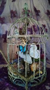 another view of center pieces 26 best enchanted forest butterfly birdcage centerpieces images on