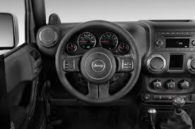 2014 jeep wrangler uconnect 2014 jeep wrangler unlimited vs toyota 4runner trd pro