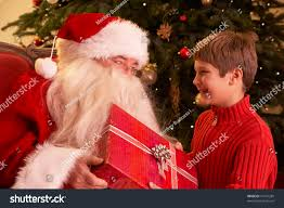 santa claus giving gift boy front stock photo 74110285 shutterstock
