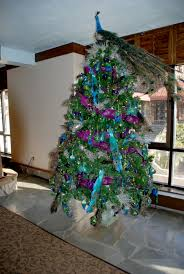 xmas tree decorating ideas with naatural peacock tree topper