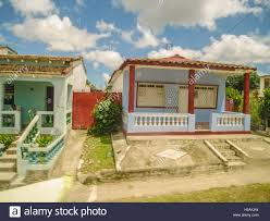 private simple low budget colorful houses in cuba stock photo