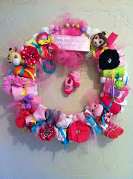 baby shower wreath complete with diapers hair bows onesies